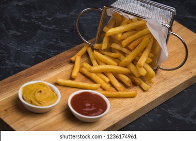 Home made french fries served in frying basket