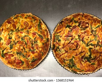 Home made french quiches (tomato, rocket feta and ham, parmesan, rocket quiches)