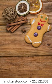 Home made gingerbread man decorating for Christmas on wooden background