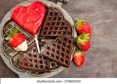 Home made heart shaped chocolate waffles served with strawberries and a heart shaped chocolate lollipop. A delicious, romantic breakfast treat.