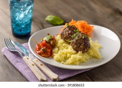Home made meatballs on mash of potatoes and tomatoe sauce