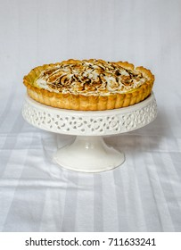 Home made Meringue pie, plated on a white porcelain cake stand.