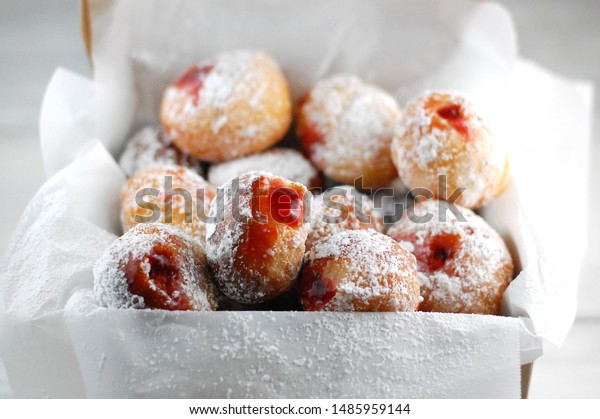 Home made mini donuts filled with jam sprinkled with powdered sugar, mini donuts in a box, sweets, desert, sweet life, sweet surprise