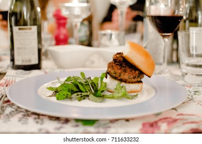 Home made mini lamb burger, served at a dinner party.