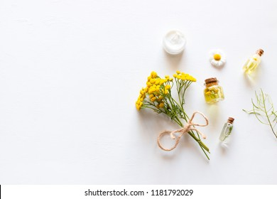 home made natural cosmetics on a white background with space for text