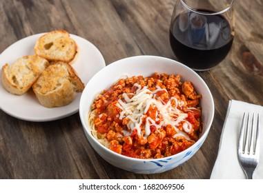 Home made pasta dinner, spaghetti, garlic bread and red wine