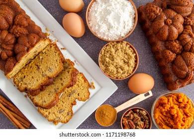 Home made pecan pumpkin bread made in fall themed loaf pan surrounded by ingredients shot from above