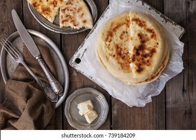 Home made pita bread with cheese on wooden table
