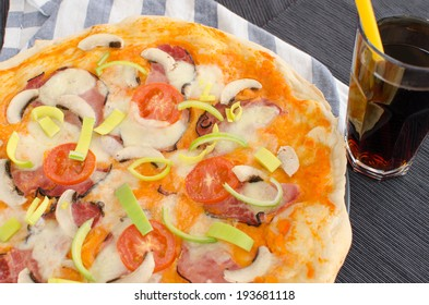Home made pizza with pork, tomato, salami and soda - Shutterstock ID 193681118