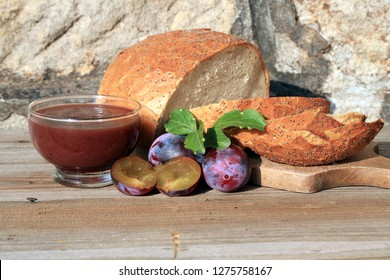 Home made plum jam and your own baking round loaf of bread. A healthy, simple and tasty second breakfast on the farm.