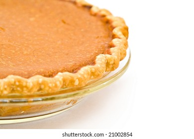 Home Made Pumpkin Pie fresh from my oven - white background.