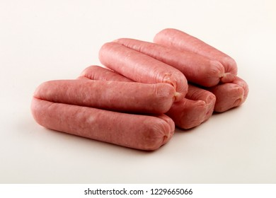 home made raw british pork sausages on bright background