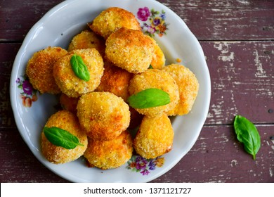 Home made rice and tuna fish  diet croquette. Italian  oven baked rice balls with mozzarella, parmesan cheese , fish  and fresh parsley and dill