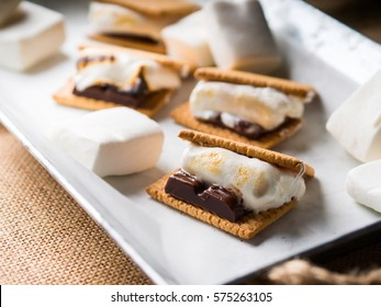Home made smore marshmallow treat for kids children with dark chocolate, cookies and smoked marshmallow
