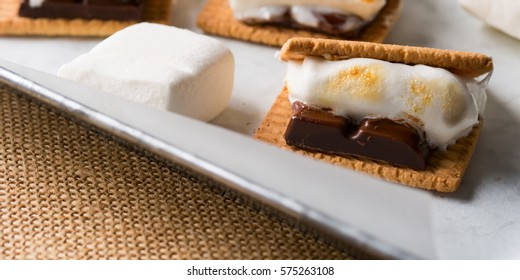 Home made smore marshmallow treat for kids children with dark chocolate, cookies and smoked marshmallow. Banner