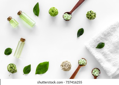 home made spa cosmetic with tea olive oil and salt for bath on white background top view frame