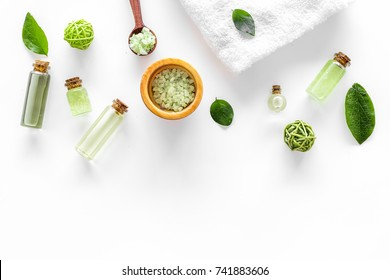home made spa cosmetic with tea olive oil and salt for bath on white background top view mock-up