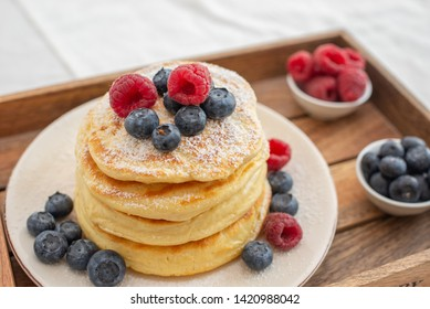 home made sweet pancakes with berries for breakfast