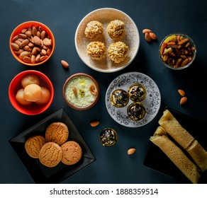 Home made tasty Diwali food snacks,sweets with dry fruits in white bowls, Favourite recipe of India.  lohri festival kheer
