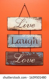 Home made wall hanging with a motivational and inspirational words of love, laugh and live.