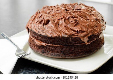 Home made whole chocolate cake with chocolate icing