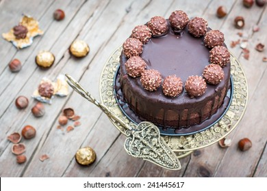Home made whole chocolate cake with chocolate icing and famous italian chocolates