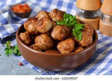 Home meatballs with spices on a concrete background