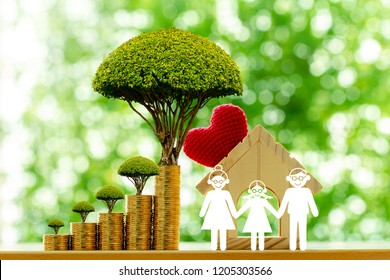 Home model and family with paper cut and red heart and stacked coin and tree  with growing value as destinations in the public park, Business investment and loan for real estate or buy house concept.