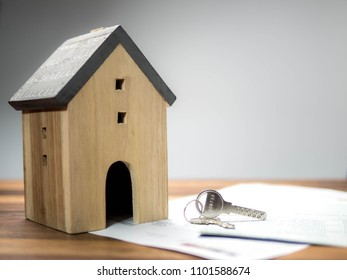 Home model with the key, building, mortgage, real estate and property concept.