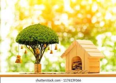 Home model and stack coin with working capital management and money bag of tree as destinations put on the table in the public park, Business investment and loan for real estate or buy house concept.
