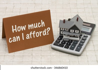 Home Mortgage Affordability, A gray house, brown card and calculator on stone background with text   How much can I afford