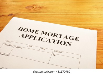 home mortgage application form on desktop in office showing real estate concept