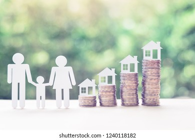 Home or mortgage loan concept : Family members, house model on stack of coins, depicts funds or short-term loans, a program offers assistance to members by providing cheap financing for housing needs