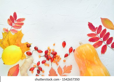 home natural pharmacy: pumpkin, lemon, ginger, sea buckthorn, autumn leaves on a white background. Place for text. For the treatment of colds, raising immunity. Autumn background.  healthcare concept.