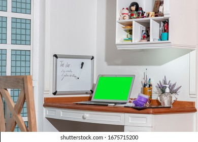 home office area with wooden desktop and white walls