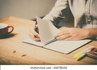home office desk background, Desk musicians, hand holding pencil and writing note on wood table,Checklist Notice Remember Planning Concept