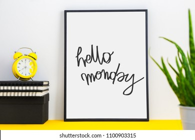 Home office desk with frame and wording Happy monday.