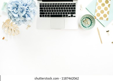 Home office desk workspace with laptop, hydrangea flowers bouquet, accessories on white background. Flat lay, top view blog hero header.