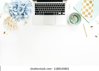 Home office desk workspace with laptop, hydrangea flowers bouquet, accessories on white background. Flat lay, top view decorated mockup.