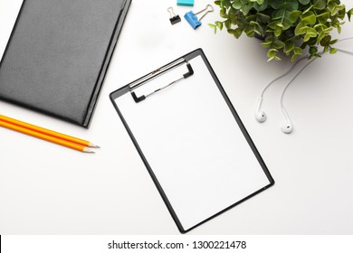 Home office workspace mockup with  clipboard. Flat lay, top view. Template for blog, bloger, business