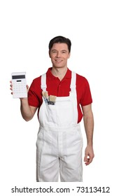 Home painter standing on white background with calculator