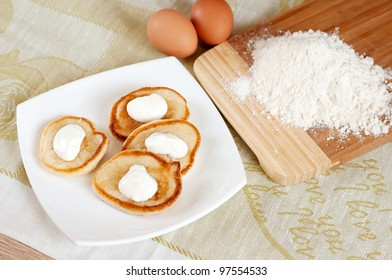 Home pancakes with sour cream, flour and eggs