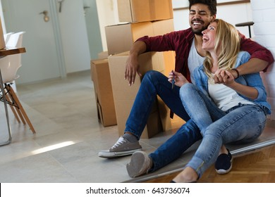 home, people, moving and real estate concept - couple in love moving in