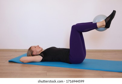 Home pilates workout with small ball. Stay healthy , stay at home concept