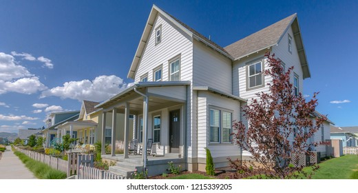 Home with porch and picket fence in Daybreak Utah