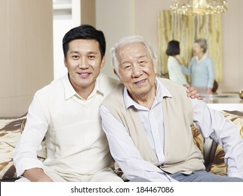 home portrait of asian father and son