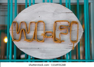 Home poster with the word wifi made with wood and strings