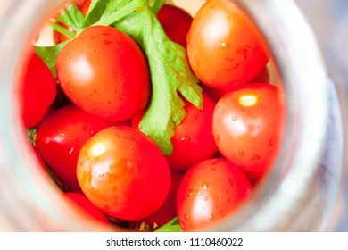 Home preservation. Ripe red tomatoes in the process of canning.
