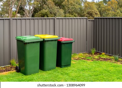 Home recyclable, green and general rubbish wheelie bins set provided by Australian local council for house waste management