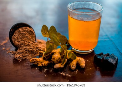 Home remedy to reduce headache or to treat headache on wooden surface i.e. Hing or Devil's dung powder well mixed in water.